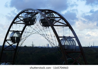 Outlook with 'sun wheel', horizon and cloudy sky at the mine 'Zollverein', Essen, Germany, October 2017