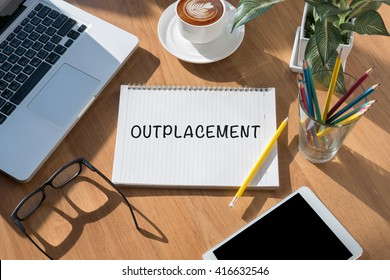 OUTPLACEMENT open book on table and coffee Business