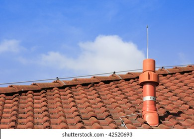 Output air tube on a roof with lightning conductor