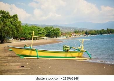 Outrigger boat ot the beach in Lovina, Bali, Indonesia