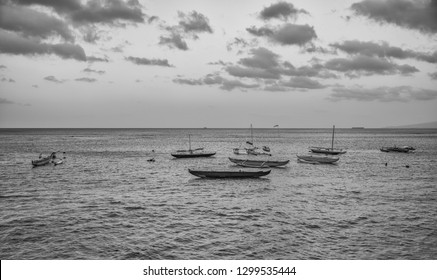 Outrigger Canoes anchored in the shallows along Waikiki Beach.