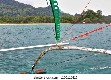 Outrigger projecting from a Filipino bangka boat-lateral support float for stabilization fastened to the main hull. Way from Sabang to Puerto Princesa Subterranean River Nnal.Park. Palawan-Philippines