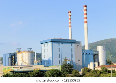 outside of the factory with smokestack in north Italy