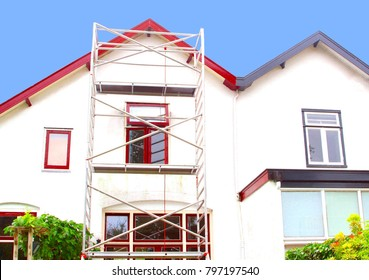 Outside house painting, before and after, and scaffold tower