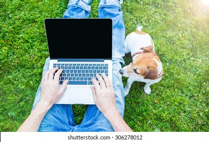 Outside laptop typing chatting with dog. Summer work.