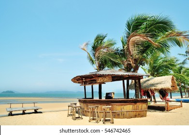 outside lounging relax vacation beach bar blue paradise sea and coconut tree in travel easy slow chill refreshment summer location using for copy space background serving alcohol drink