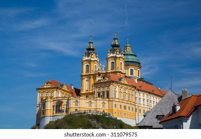 The outside of Melk Abbey in Austria during the day in the summer. There is space for text.