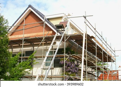 Outside renovation of a modern house, scaffolding tower