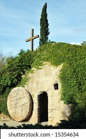 The outside of a replica of the Garden Tomb where Jesus was buried, the stone rolled away from the entrance.