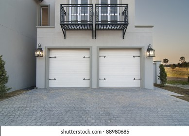 Outside shot, showing the garage and portion of a modern house