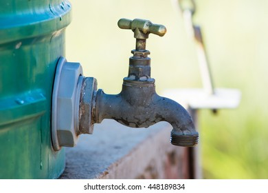 Outside tap on a plastic water tank