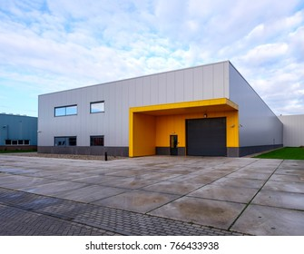 Outside view of a small, empty warehouse in an industrial area