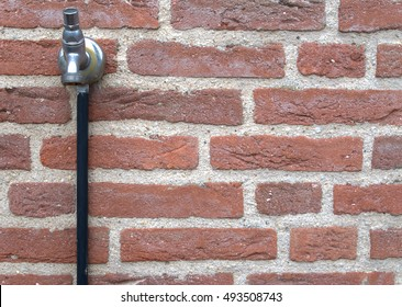 outside water tap. The handle has been removed in order to prevent random and vandal use by others.