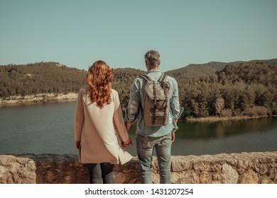 outsight enjoying couple on the lake