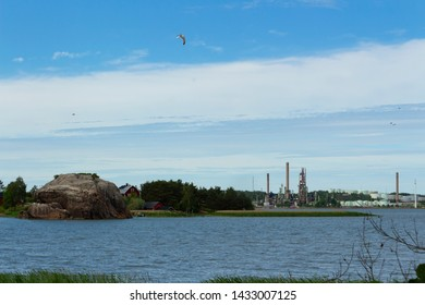 Outskirts of the city of Turku on a summer day where nature is adjacent to industrial buildings. Finland, Turku, Russalo Island.