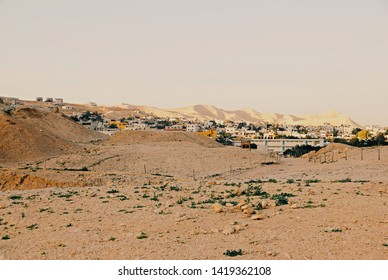 Outskirts of Jericho, with sand dunes in foreground