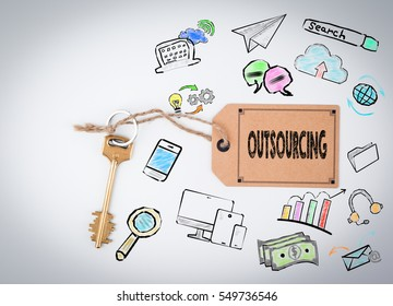 Outsourcing. Key and a note on a white background