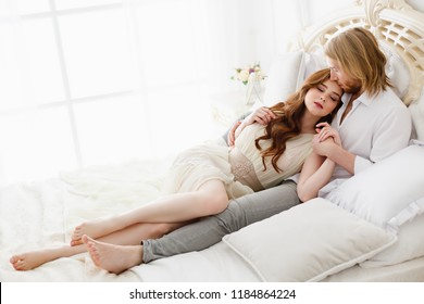 outspoken lovestory. Date for lovers. gentle relations of two lovers. Indoor relax in a light interior. Gentle hugs and touching of young man and woman. Home morning of two lovers. Sexy couple