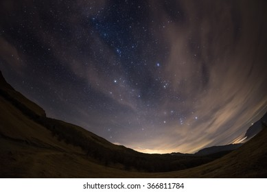 The outstanding beauty of the starry sky and Milky Way in winter season, captured by fisheye lens with scenic distortion and 180 degree view. Some digital noise due to 1600 iso setting.
