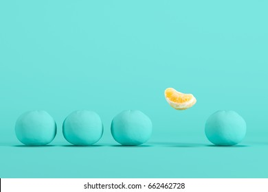 Outstanding  orange lobes floating  on pastel green background. minimal food idea concept.