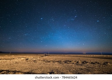 Outstanding starry sky at high altitude on the barren highlands of the Andes in Bolivia. Football ground (soccer field) in the middle of nowhere. Winter season.