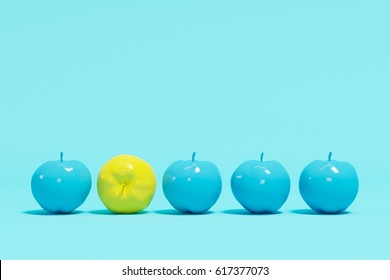 Outstanding yellow apple contrast blue appples on blue pastel background. minimal concept.