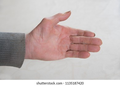 outstretched hand of an old senior grandfather