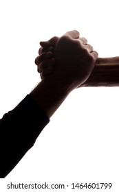 The outstretched hands of young and elderly men, salvation, help - silhouette, concept of help