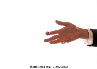 An outstretched male hand in marriage proposal (isolated)