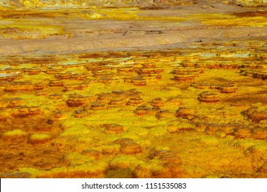 Out-this-planet view to Danakil Depression and sulfur, salt, potassium, calcium and ferrum mineral fields in hottest place on Earth