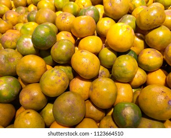 Outward appearances can be deceiving, with this delicious and fresh green and orange stack of sweet, North Shokun oranges, naturally scarred and colored, and grown in Thailand.