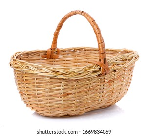 Oval brown wicker basket made of natural vine. Isolated. Handmade.