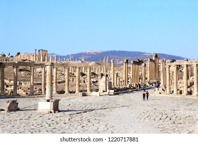 Oval Plaza with ionic columns in Jerash (Gerasa), ancient roman capital and largest city of Jerash Governorate, Jordan, Middle East. UNESCO world heritage site