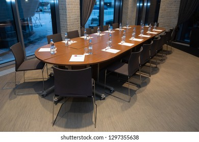 Oval table with water bottles