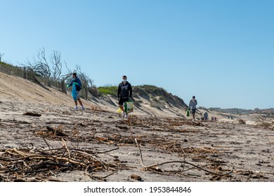 Ovar, Portugal - CIRCA APRIL 2021: Activity of Portuguese volunteer group keeping plastic waste out from Furadouro beach in Ovar, Portugal. Environmental pollution. Conservation, friendship.