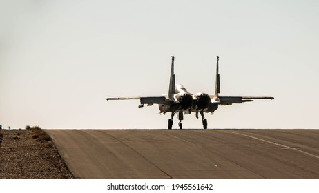 """Ovda, Israel - January 08, 2018: A rear view of the McDonnell Douglas F-15 Eagle """"Baz"""" of the Israeli Air Force takes off from Ovda Air Force base in the Negev"""