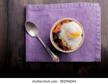 Oven baked breakfast egg on salad