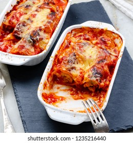 Oven baked cannelloni with chicken, cheese and tomato past