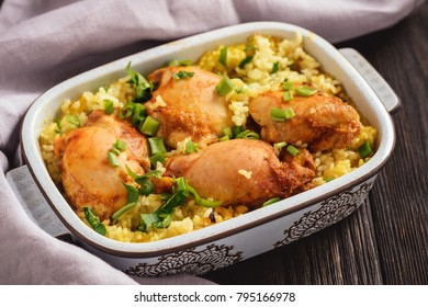Oven baked chicken meat with rice.