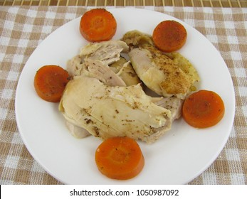 Oven baked chicken meat with tasty carrots