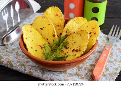 Oven baked halves of potato with spices and olive oil. Healthy eating concept. Mediterranean lifestyle