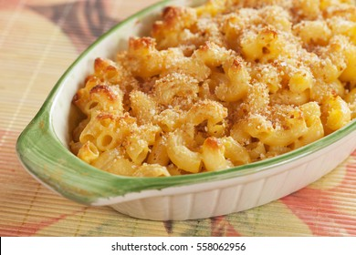 Oven baked mac and cheese, american style macaroni pasta with cheesy sauce