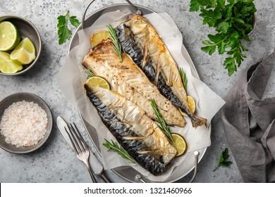 oven baked mackerel, grey background, top view