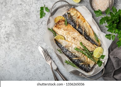 oven baked mackerel, grey background, top view, copy space