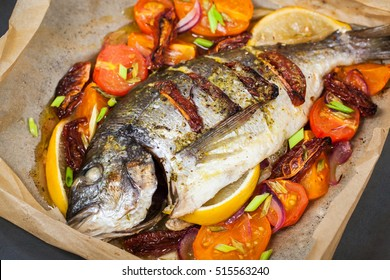 Oven baked whole sea bream fish (dorado) with vegetables, ready to eat