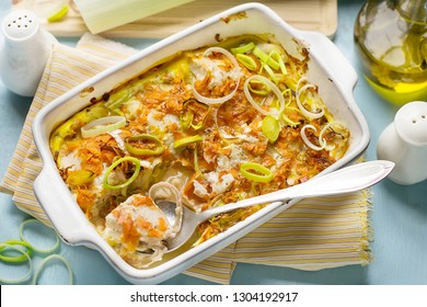Oven dish gratin with cod fish, grated carrots and leeks
