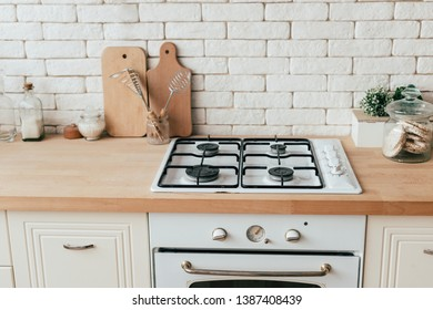 oven, rice waffles, cooking utensils and plants in kitchen