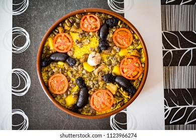 Oven-Baked rice from Valencia, Spain. Made with pork rib, beans, blood sausage, garlic, tomato, potato and rice.