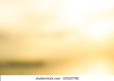 Over blur beautiful colorful sunset above  sea and could sky texture background with boat and sun shine
