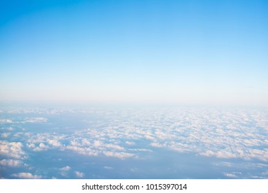 over the clouds, view from airplane window